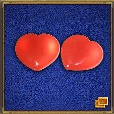 Красные или розовые сердечки (обязательно парные) - один из самых сильных любовных талисманов. Самые лучшие сердечки - изготовленные из розового кварца.